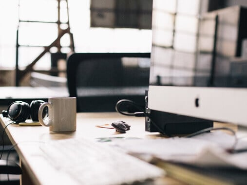 Freelance-designers-workspace-coffee-headphones
